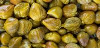 La venta de alcaparras / alcaparras sueltas es una cultura emblemática de la región de...